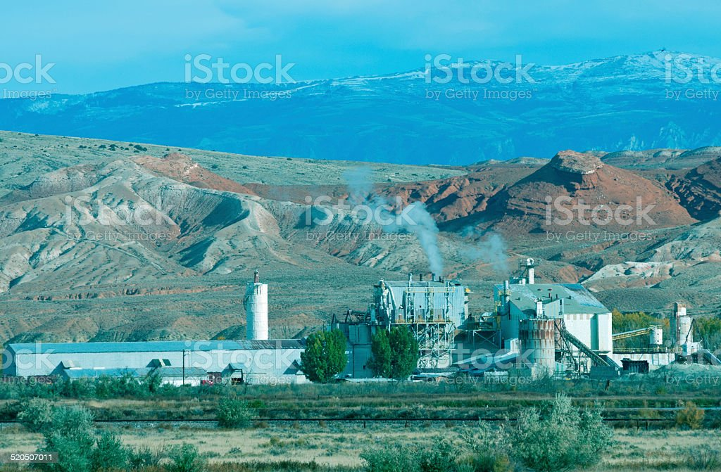 Potash plant and Bighorn Mountains in northern Wyoming stock photo