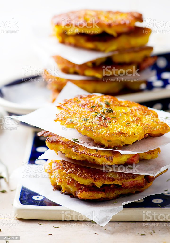 potato  and carrot fritters with a sausages stock photo
