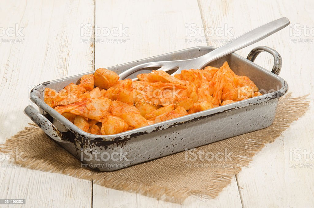 potato and pasta, hungarian meal in a baking tin stock photo