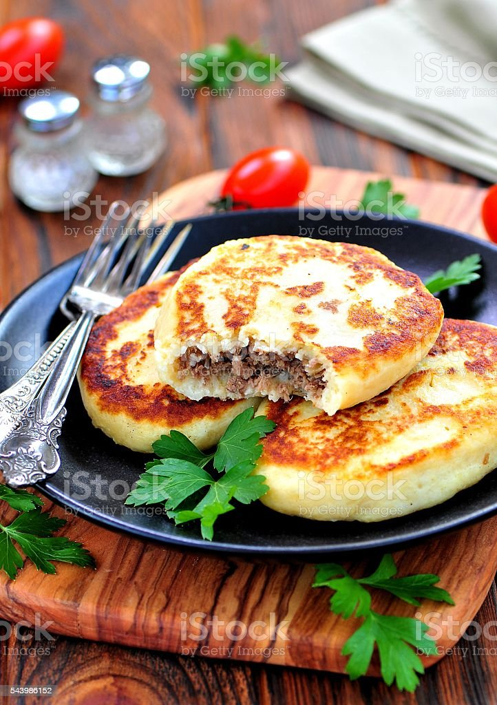 Potato cakes with meat and onions stock photo
