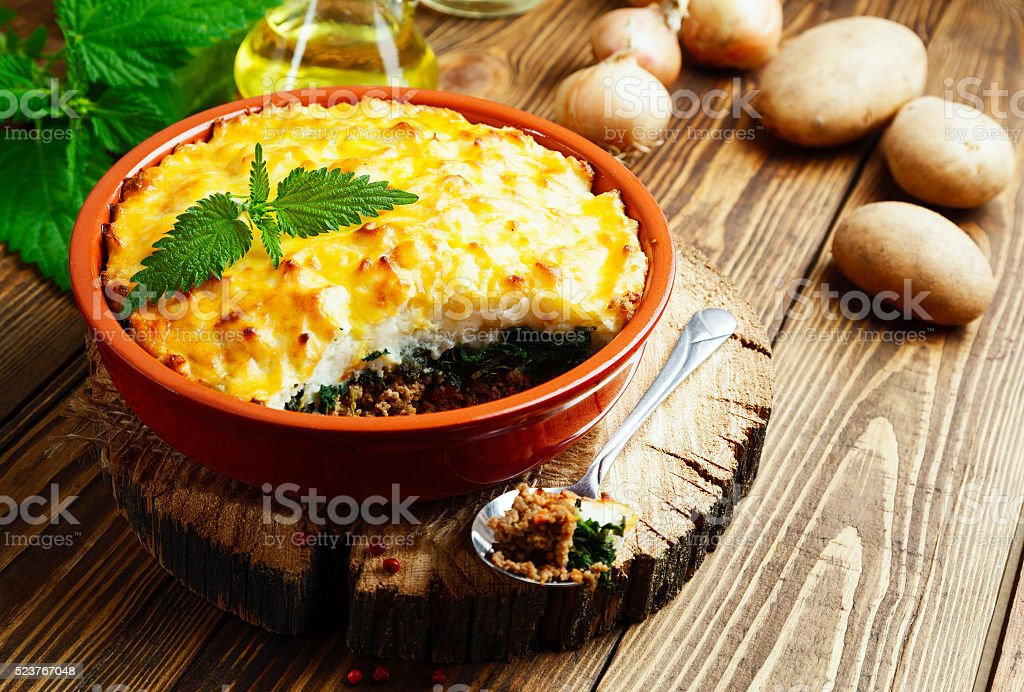 Potato casserole with meat and nettle stock photo