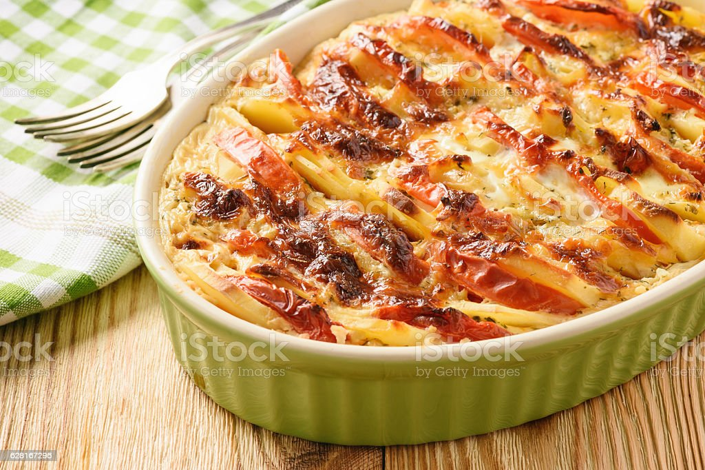 Potato casserole with tomatoes, garlic and cheese. stock photo