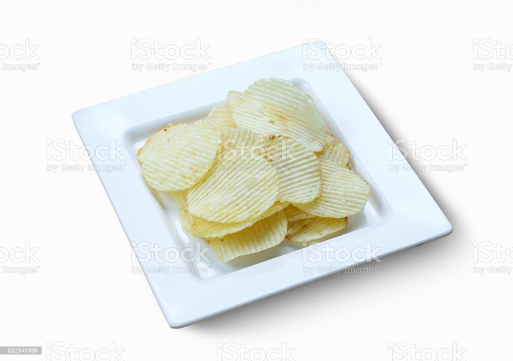 Potato chips and soft drink in glass on wood background stock photo