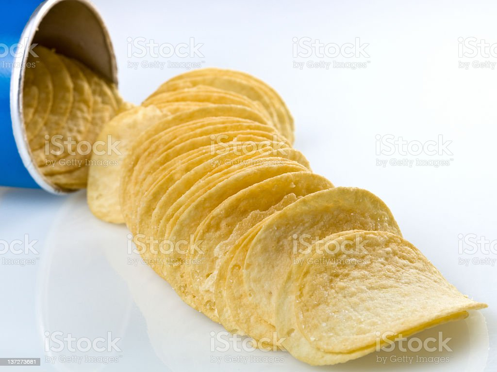 potato chips coming out of the can royalty-free stock photo