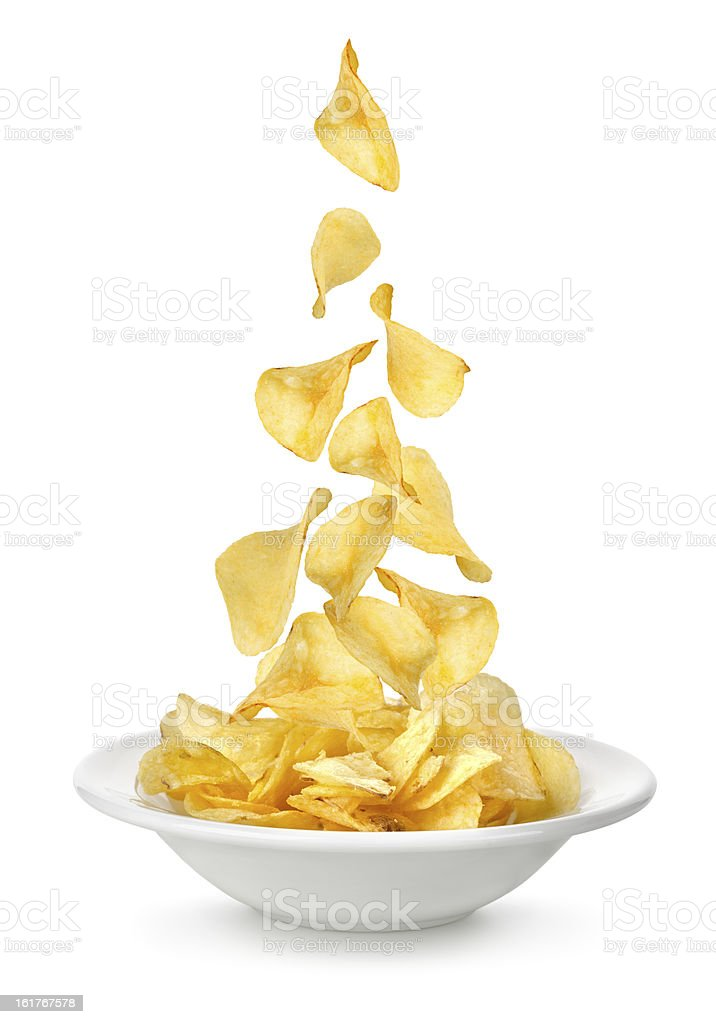 Potato chips falling in the plate stock photo
