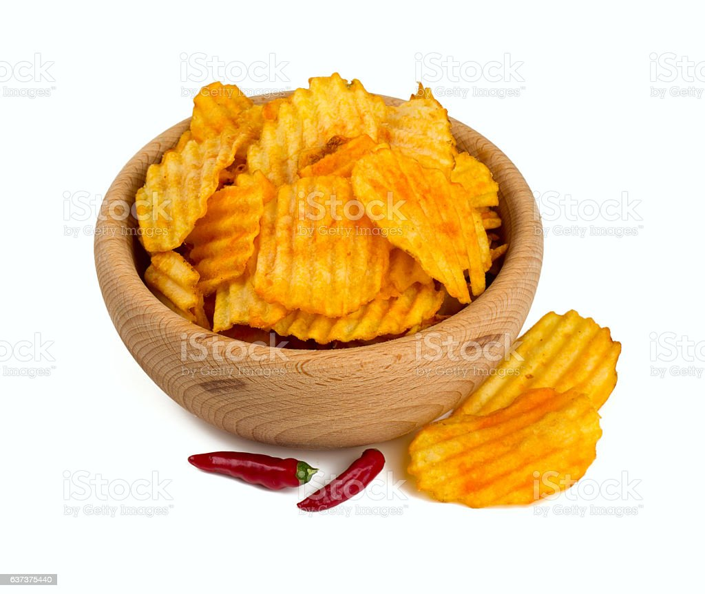 potato chips in a wooden bowl stock photo