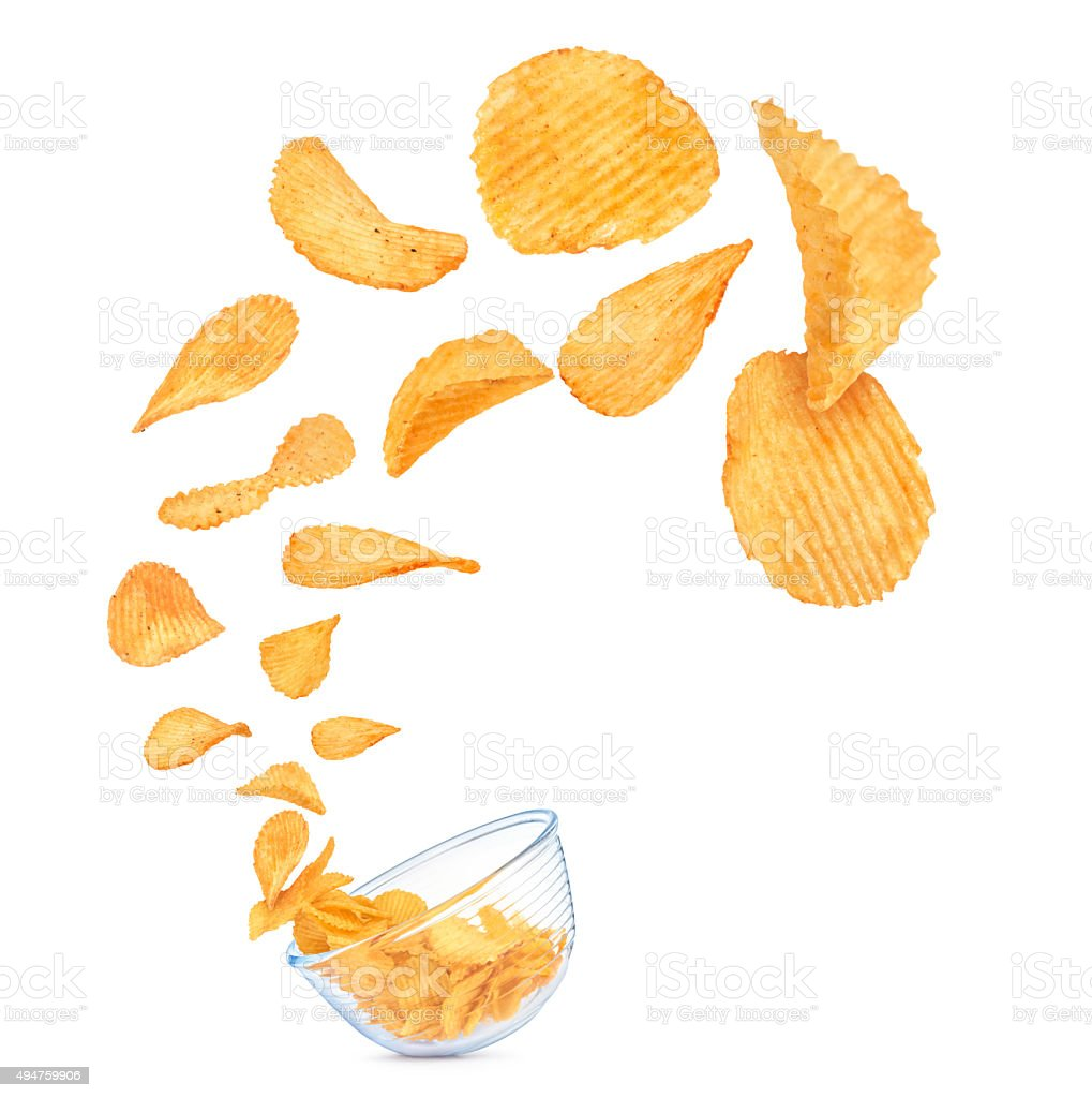 potato chips in the air fall in a bowl stock photo