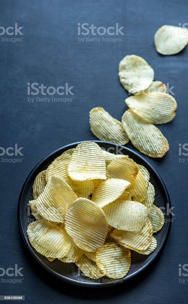 Potato chips in the bowl stock photo