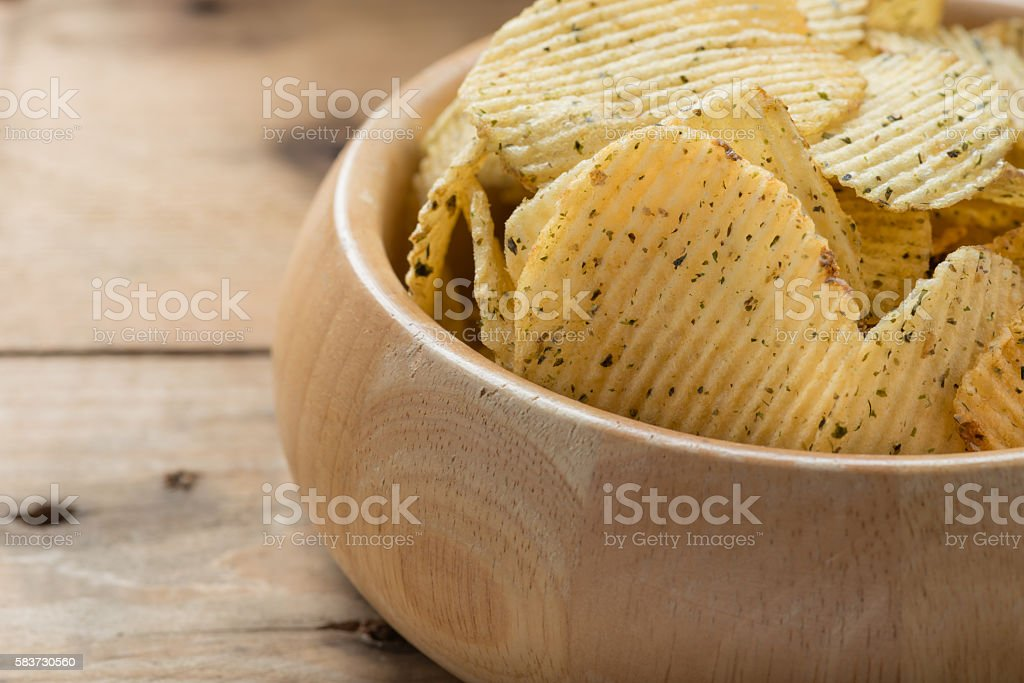 Potato chips in wooden bowls, close-up stock photo