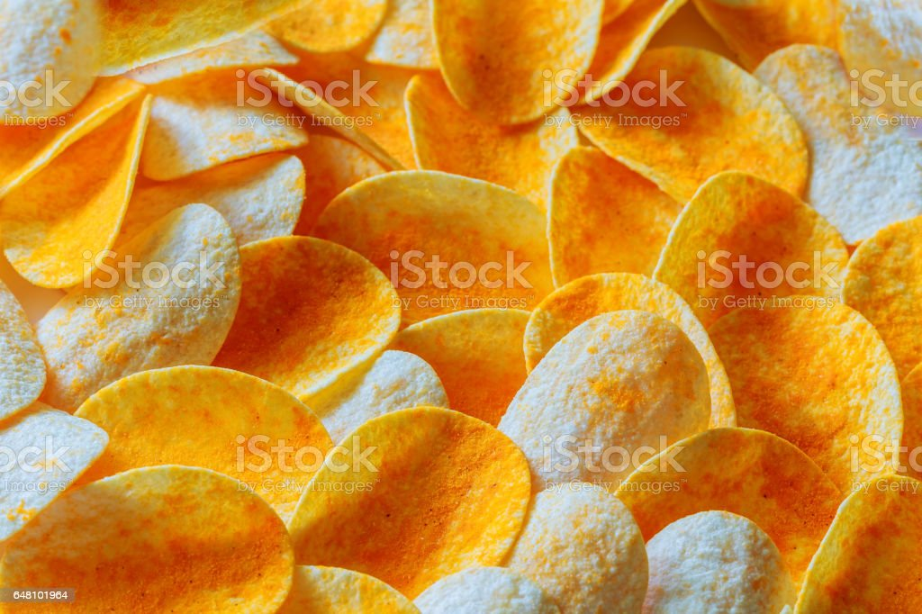Potato chips on a wooden billet stock photo