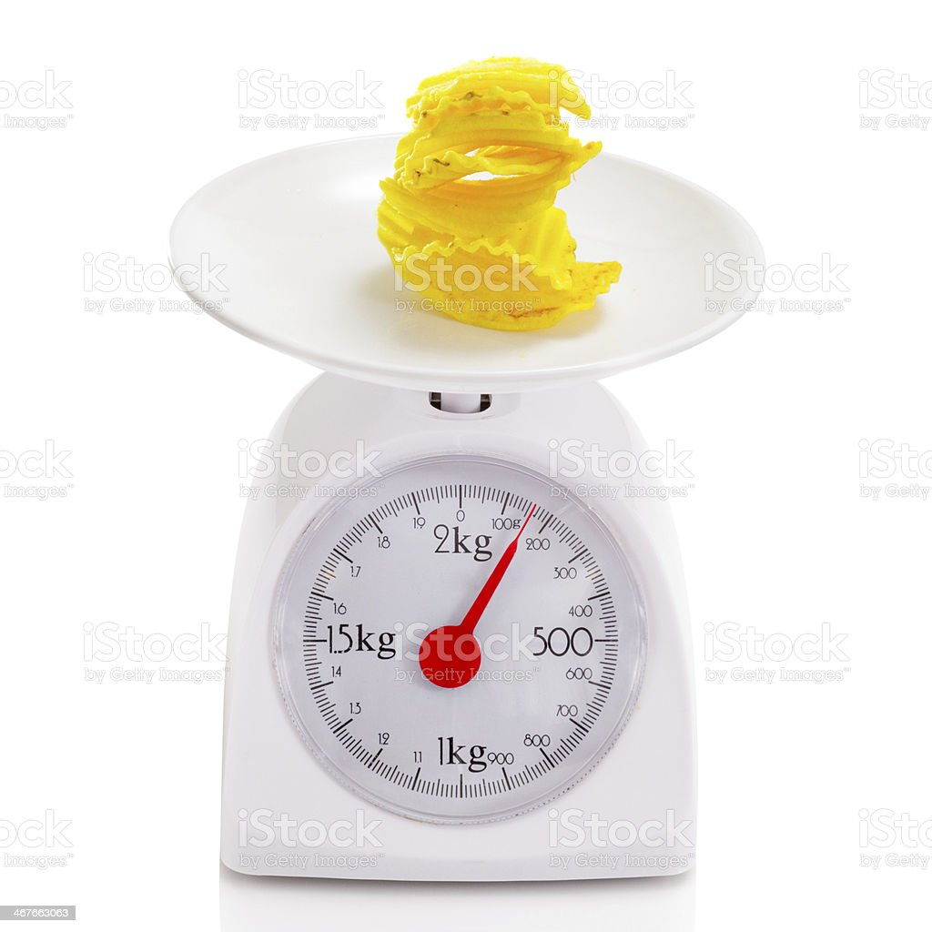 Potato chips on balance scale royalty-free stock photo