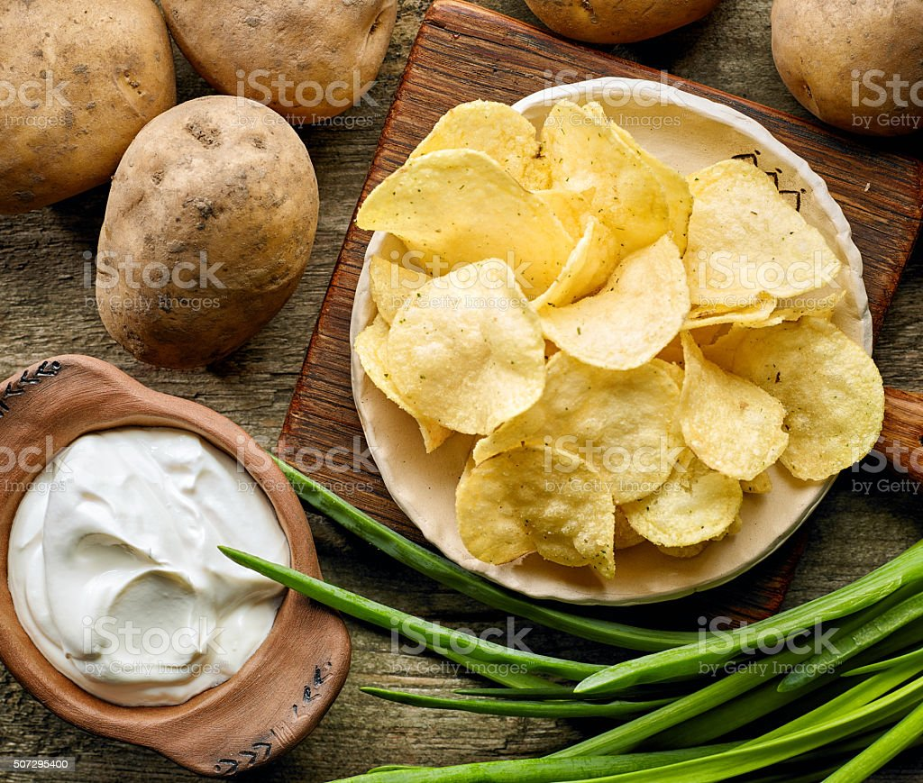 Potato chips on ceramic plate stock photo