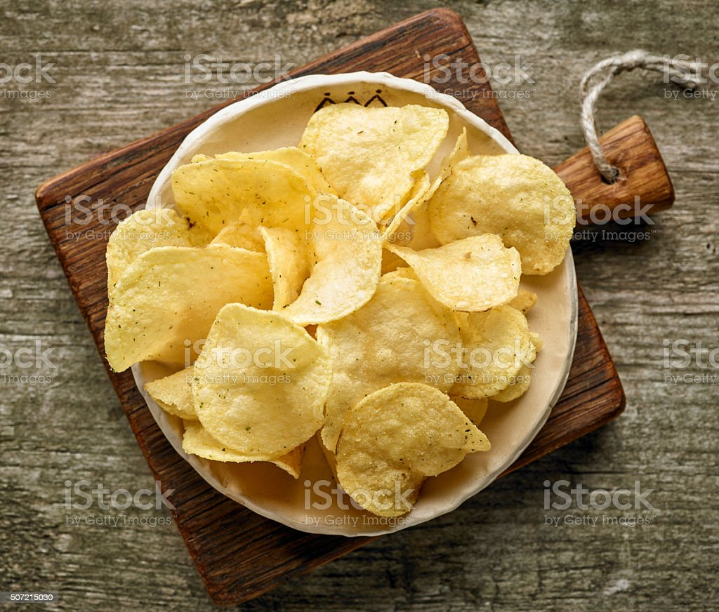 potato chips on wooden table stock photo