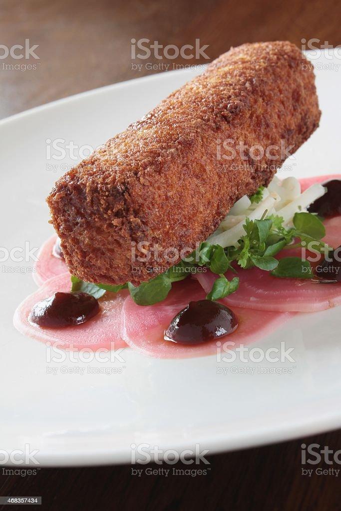 potato croquet plated appetizer stock photo