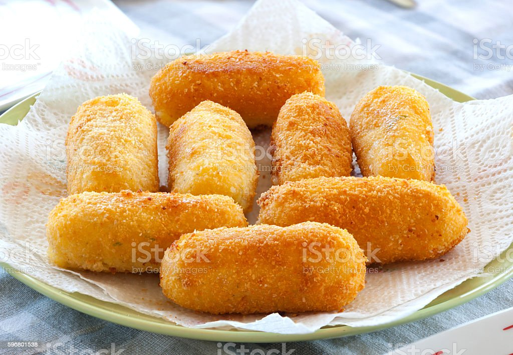 Potato croquettes fried with mozzarella cheese stock photo