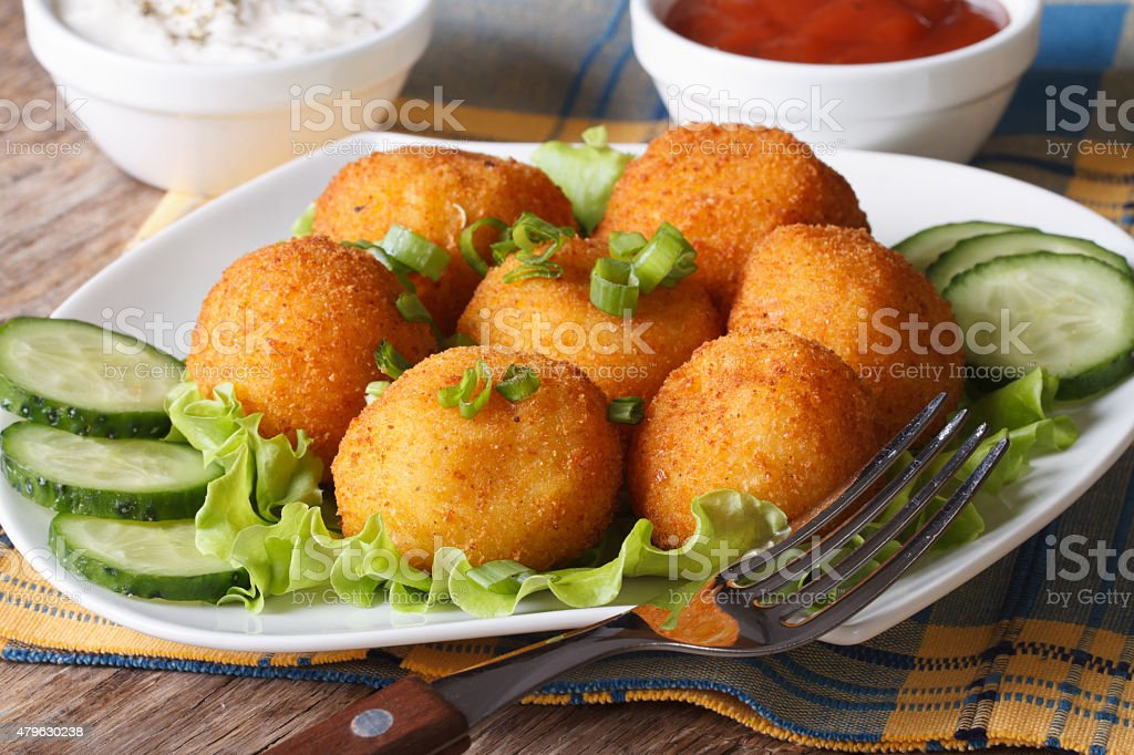 potato croquettes on a white plate close-up. horizontal stock photo