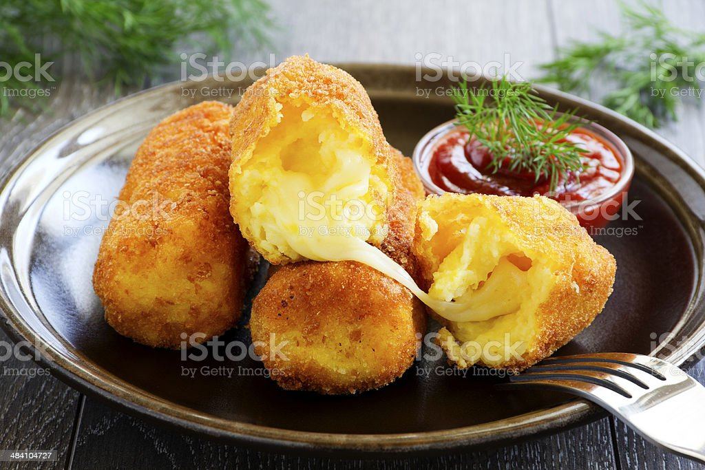 Potato croquettes with mozzarella. stock photo