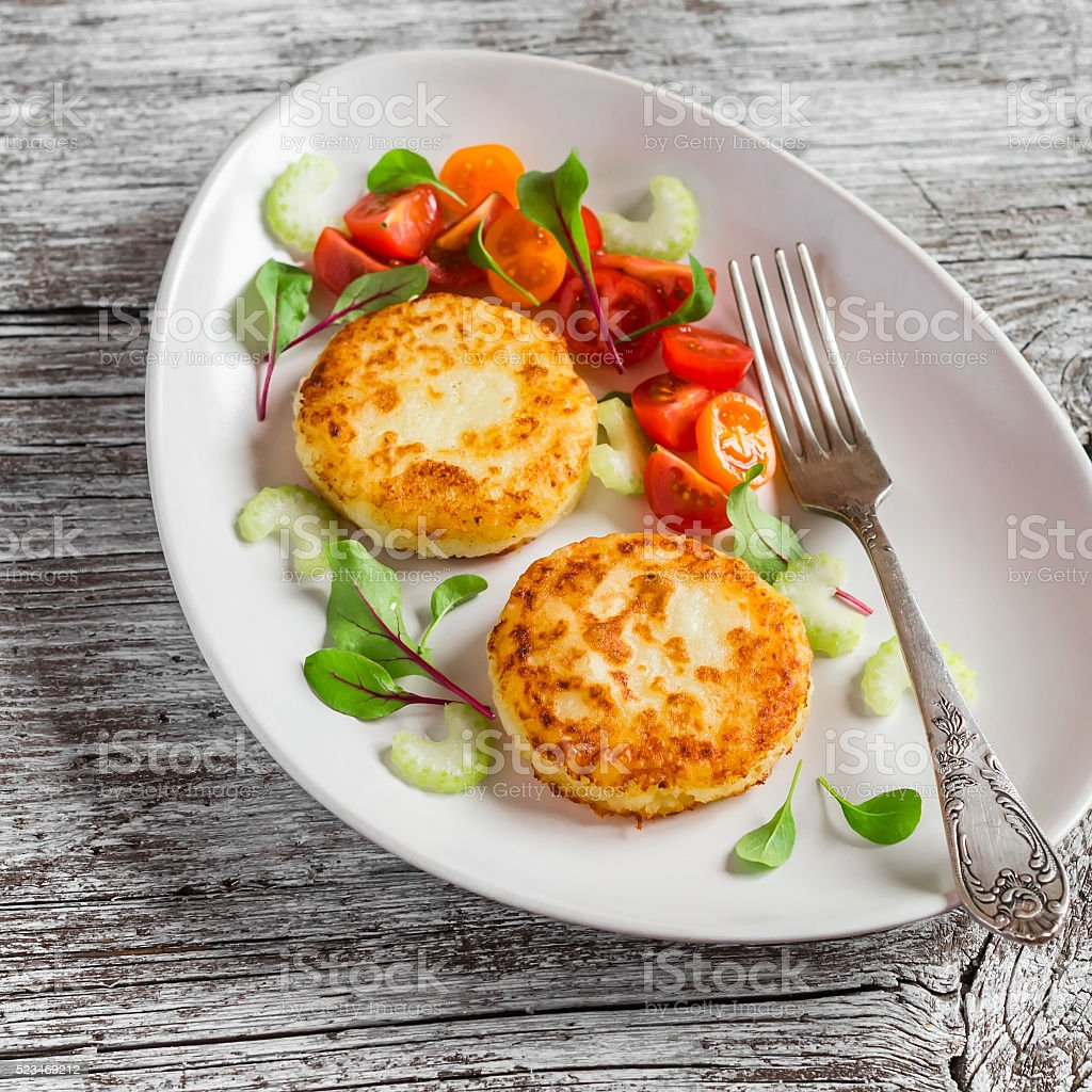 Potato cutlet  and fresh tomato and celery salad stock photo