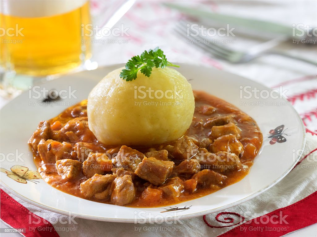 Potato dumplings with goulash royalty-free stock photo