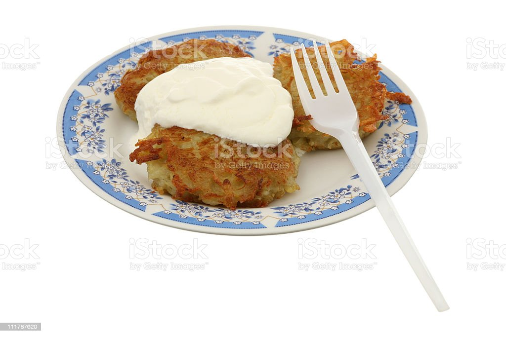 Potato fritters with sour cream royalty-free stock photo