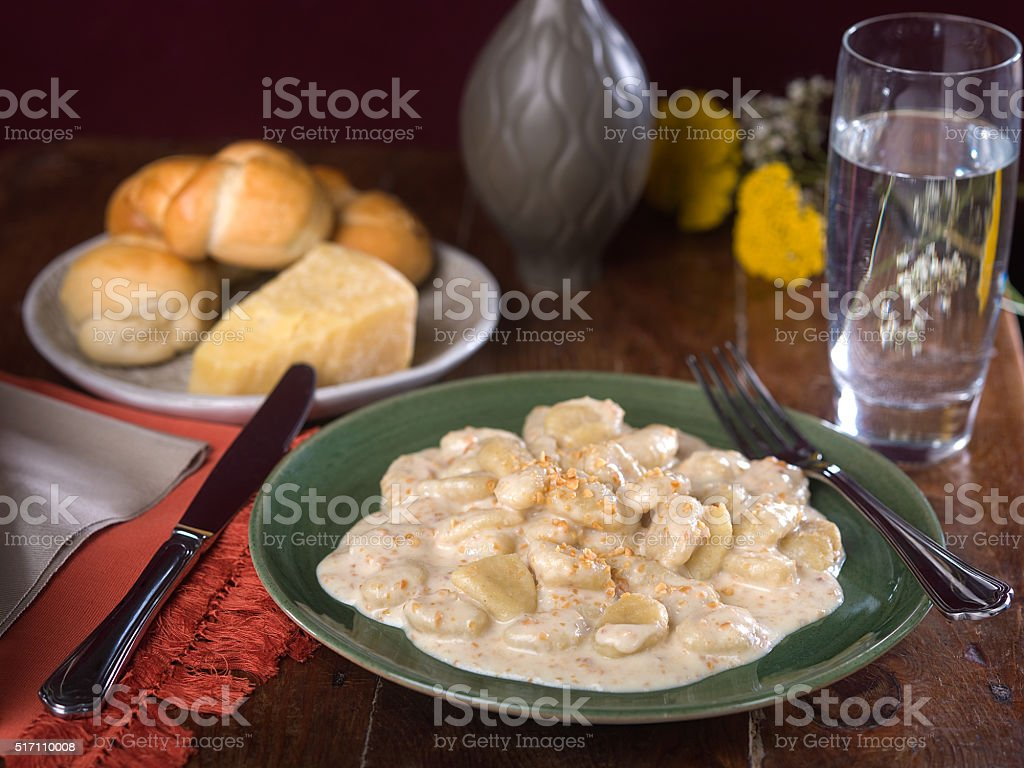 Potato Gnocchi in Creamy Alfredo Sauce stock photo