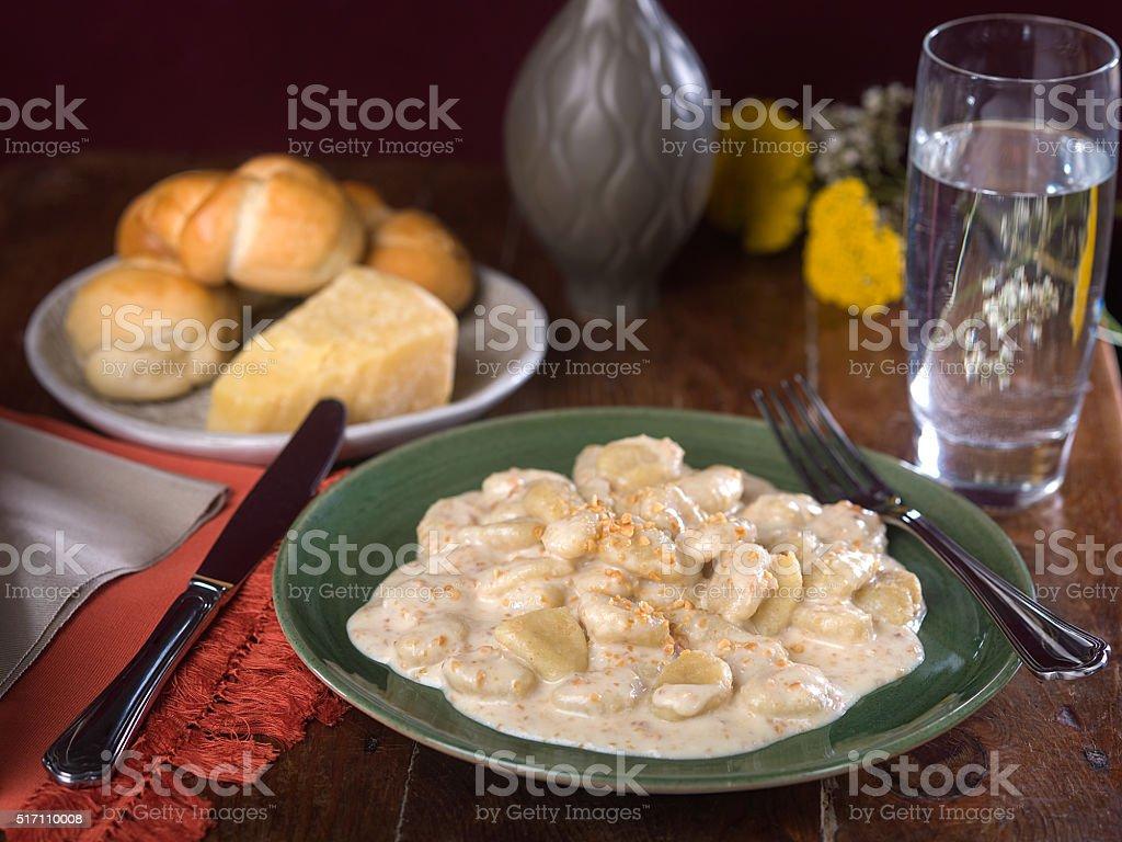 Potato Gnocchi in Creamy Alfredo Sauce stock photo