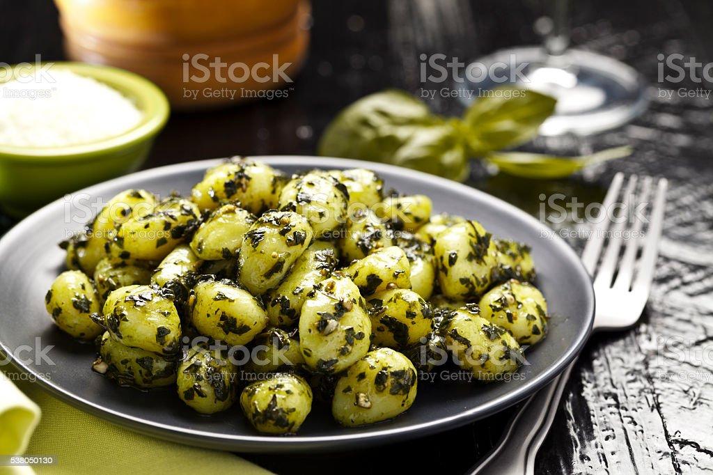 Potato gnocchi with pesto sauce stock photo