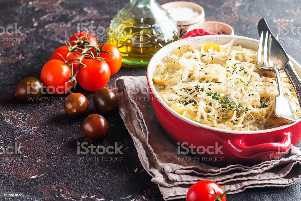 Potato gratin, in rustic dish. stock photo