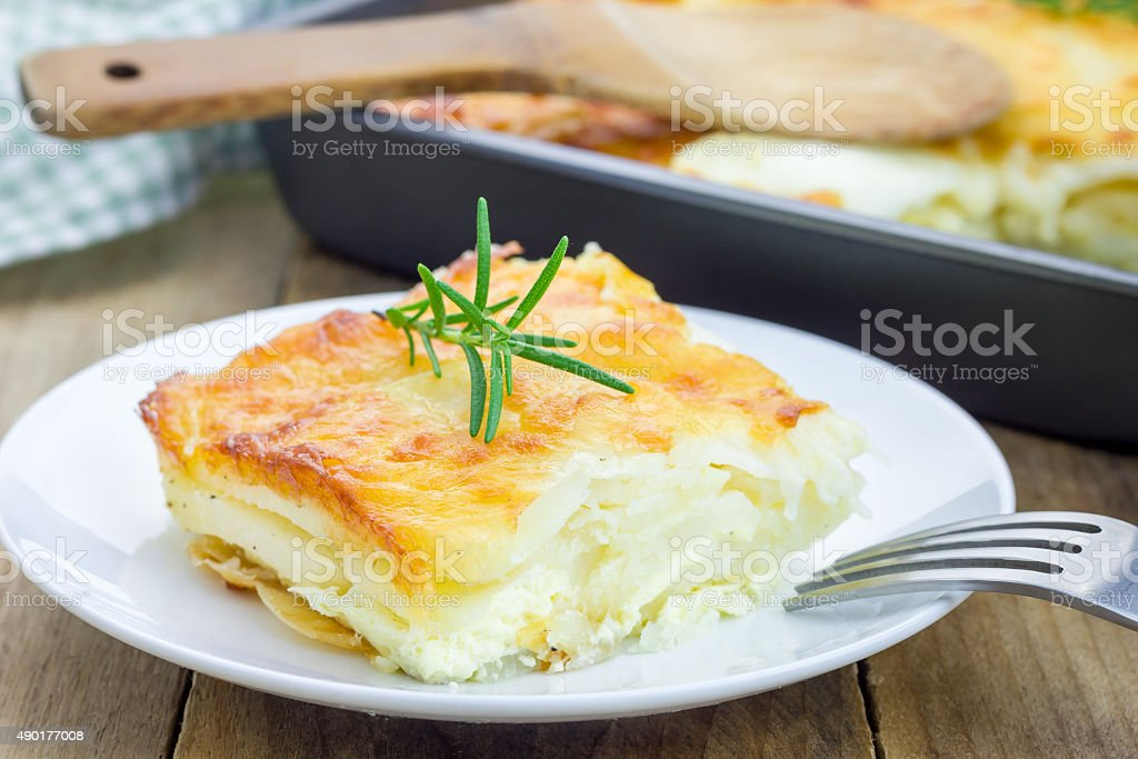 Potato gratin on a white plate stock photo