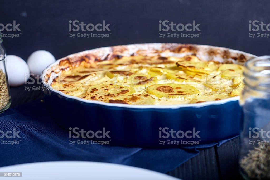 Potato gratin with cream, eggs and cheese stock photo