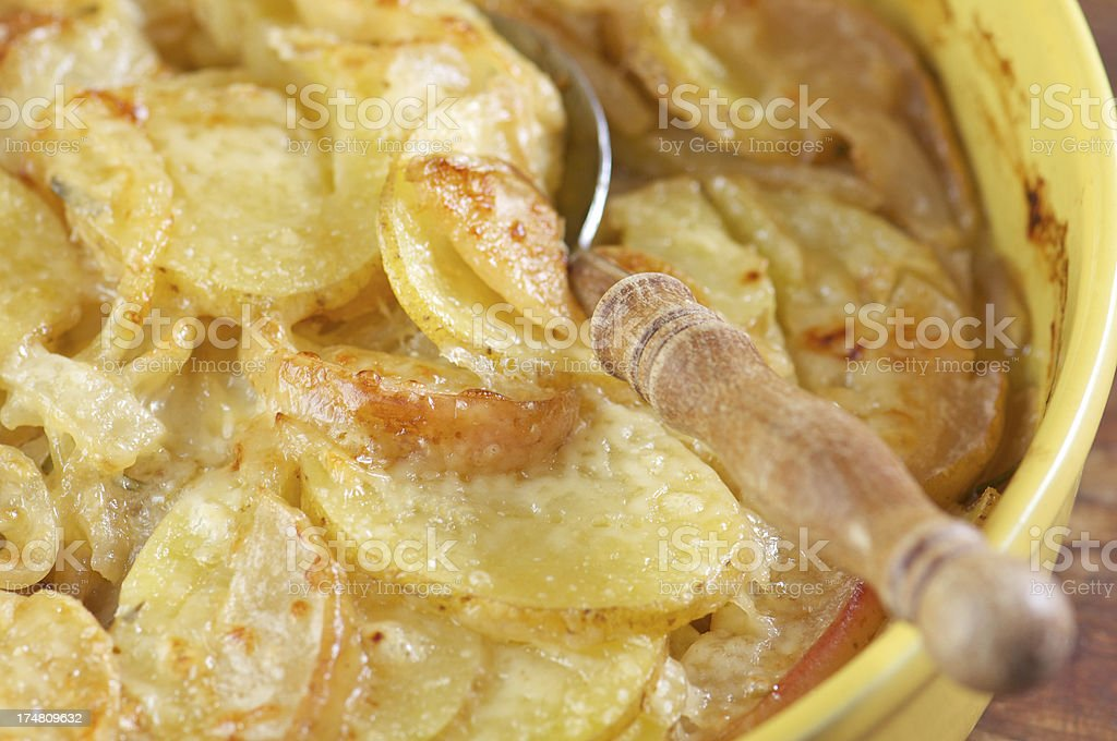 Potato Gratin with Melted Cheese in Yellow Baking Dish royalty-free stock photo