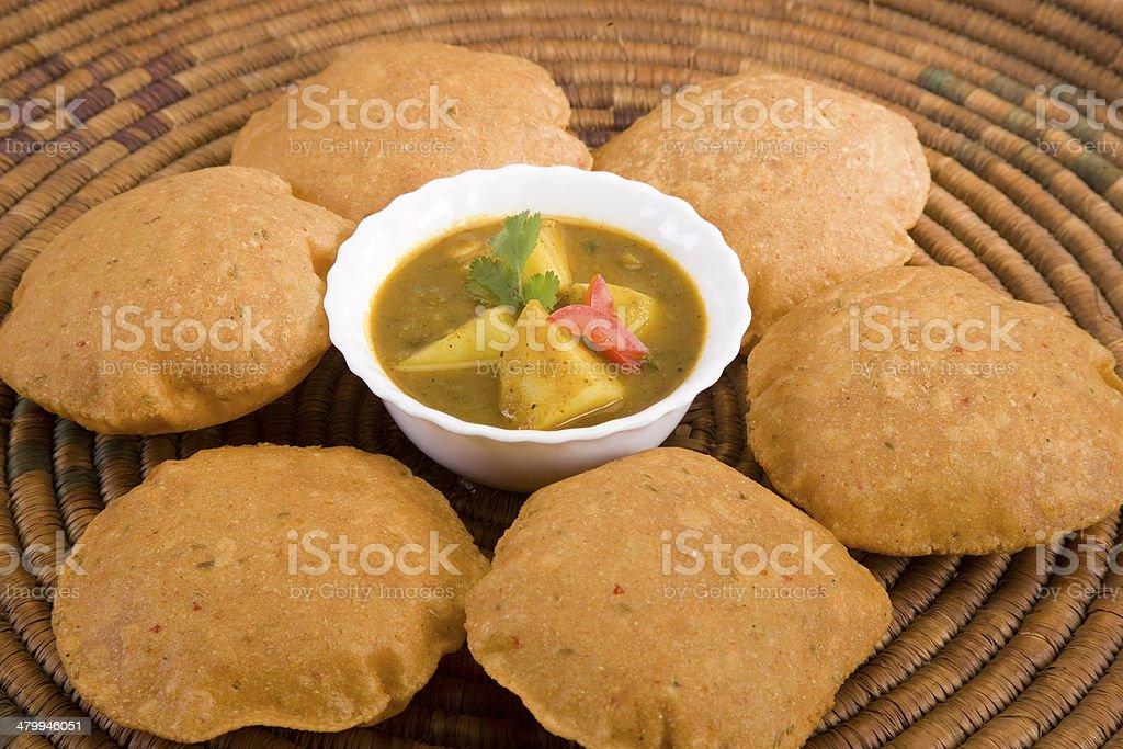Potato Masala Curry with Puri stock photo