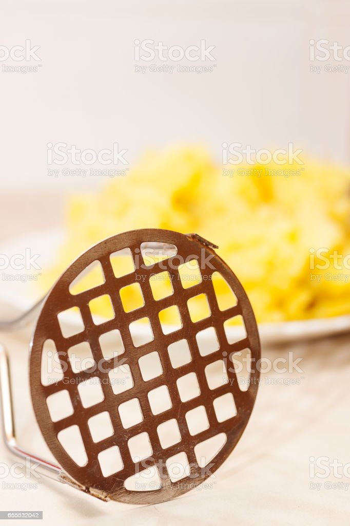 potato masher closeup stock photo