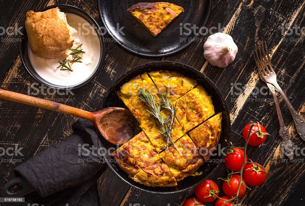 Tortilla de patatas in a pan stock photo