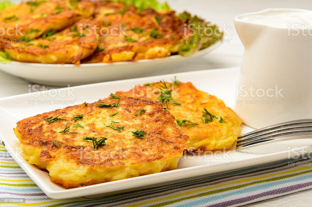 Potato pancakes on white wooden table. stock photo