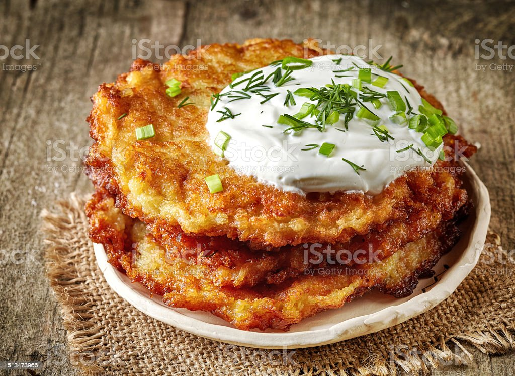 Potato pancakes on wooden table stock photo