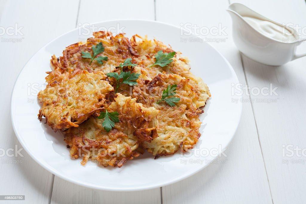 Potato pancakes or latke traditional vegetarian vegetable fried food with stock photo