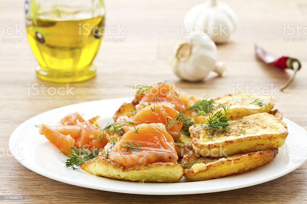 potato pancakes with salted salmon royalty-free stock photo