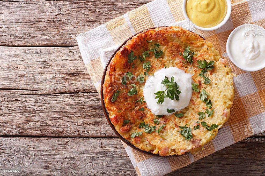 Potato pancakes with sauce on a plate. Horizontal top view stock photo