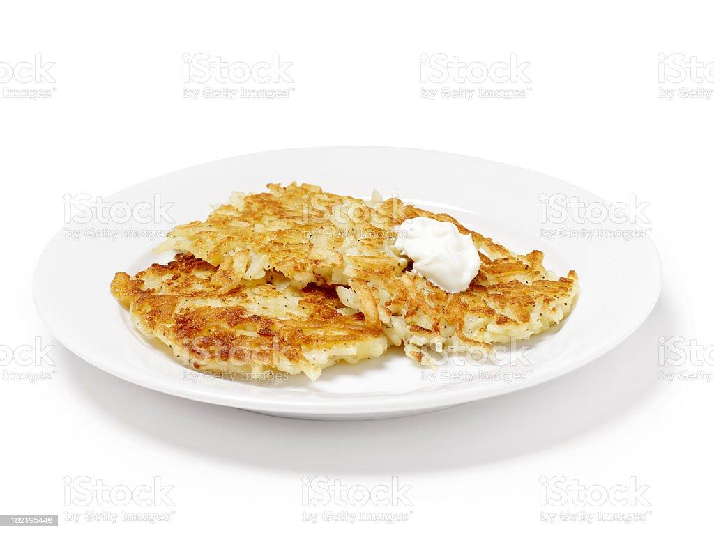 Potato Pancakes with Sour Cream stock photo