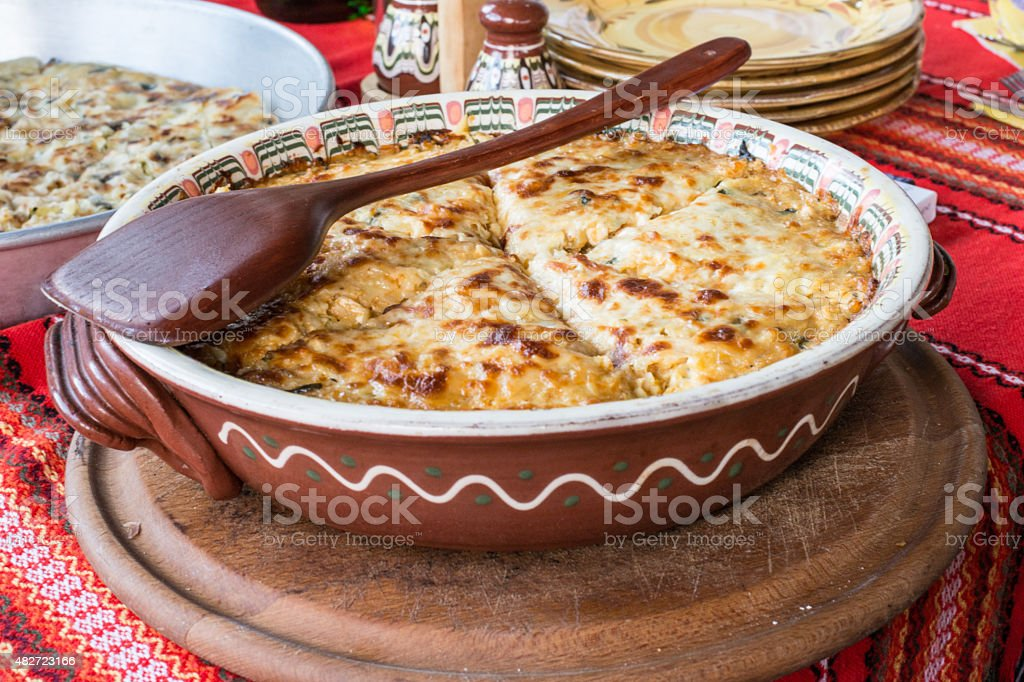 Potato pie with vegetables and cheese. Bulgarian national dish stock photo