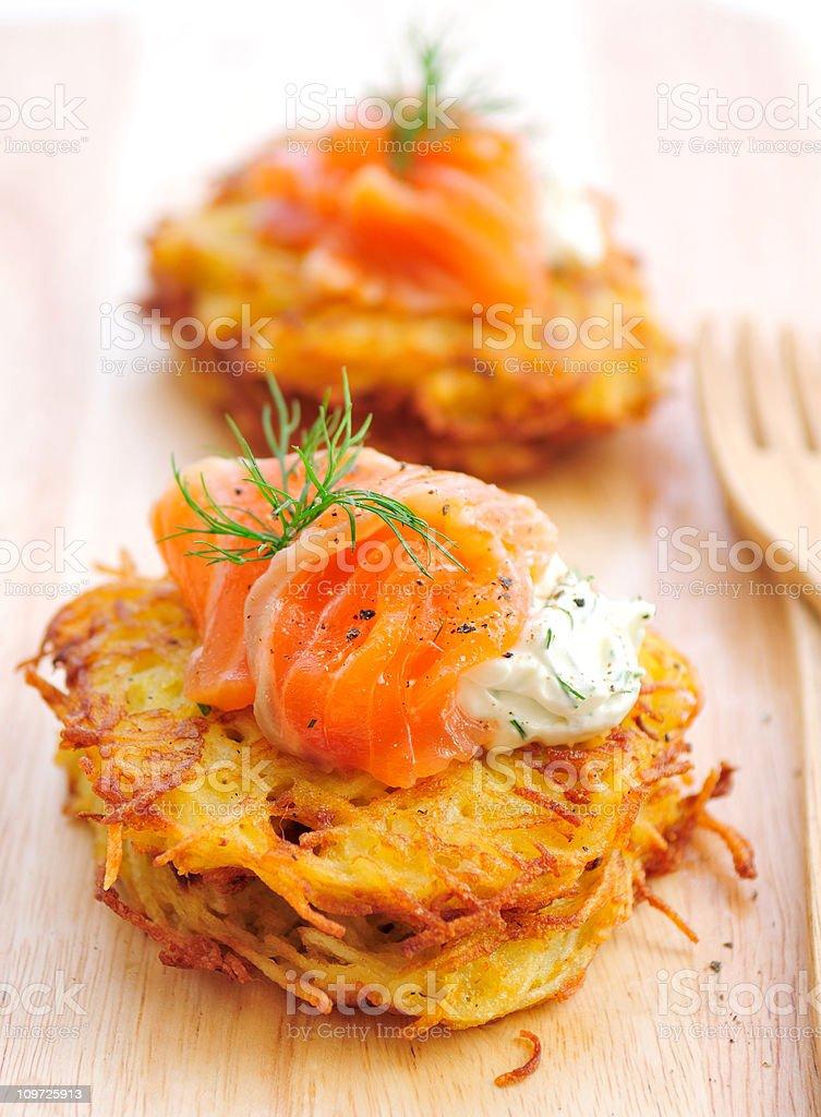 Potato Rosti Served on Wooden Cutting Board stock photo