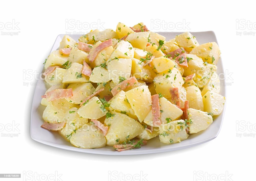 Potato salad on white rectangular plate isolated on white stock photo