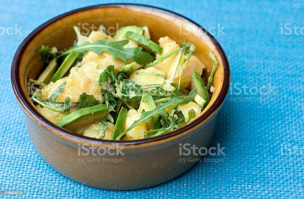 potato salad with avocado and arugula royalty-free stock photo