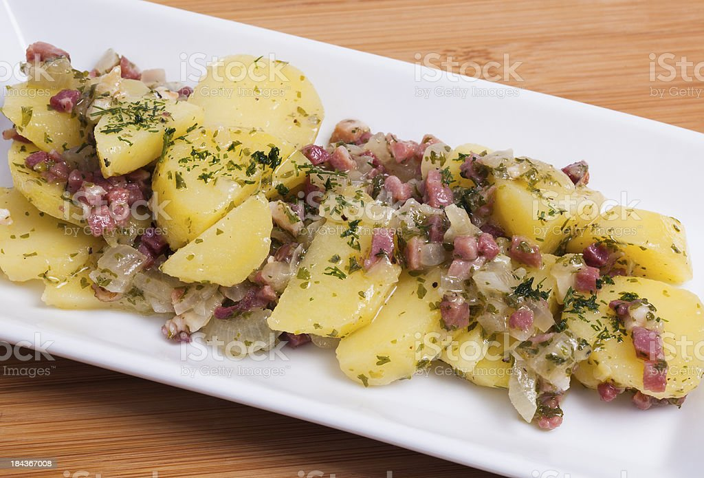 Potato salad with bacon stock photo