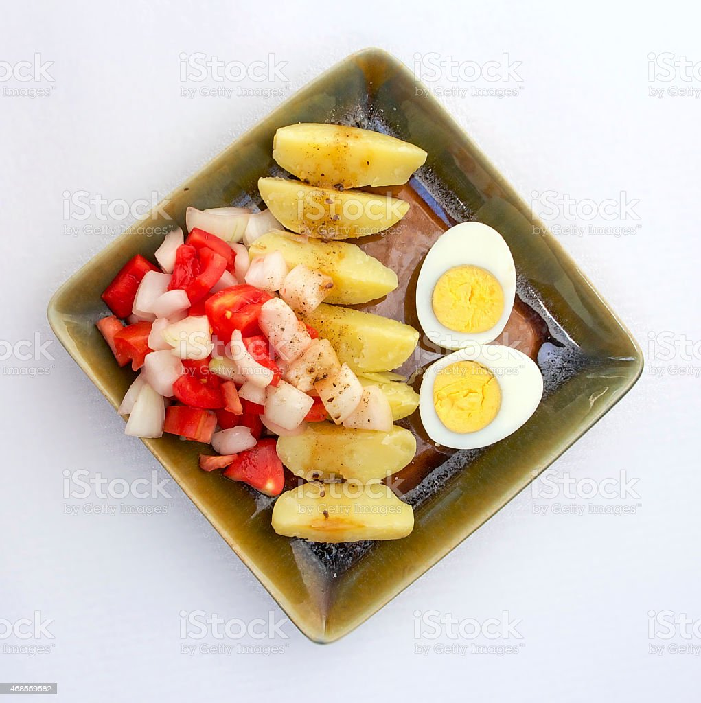 Potato salad with eggs and tomato royalty-free stock photo