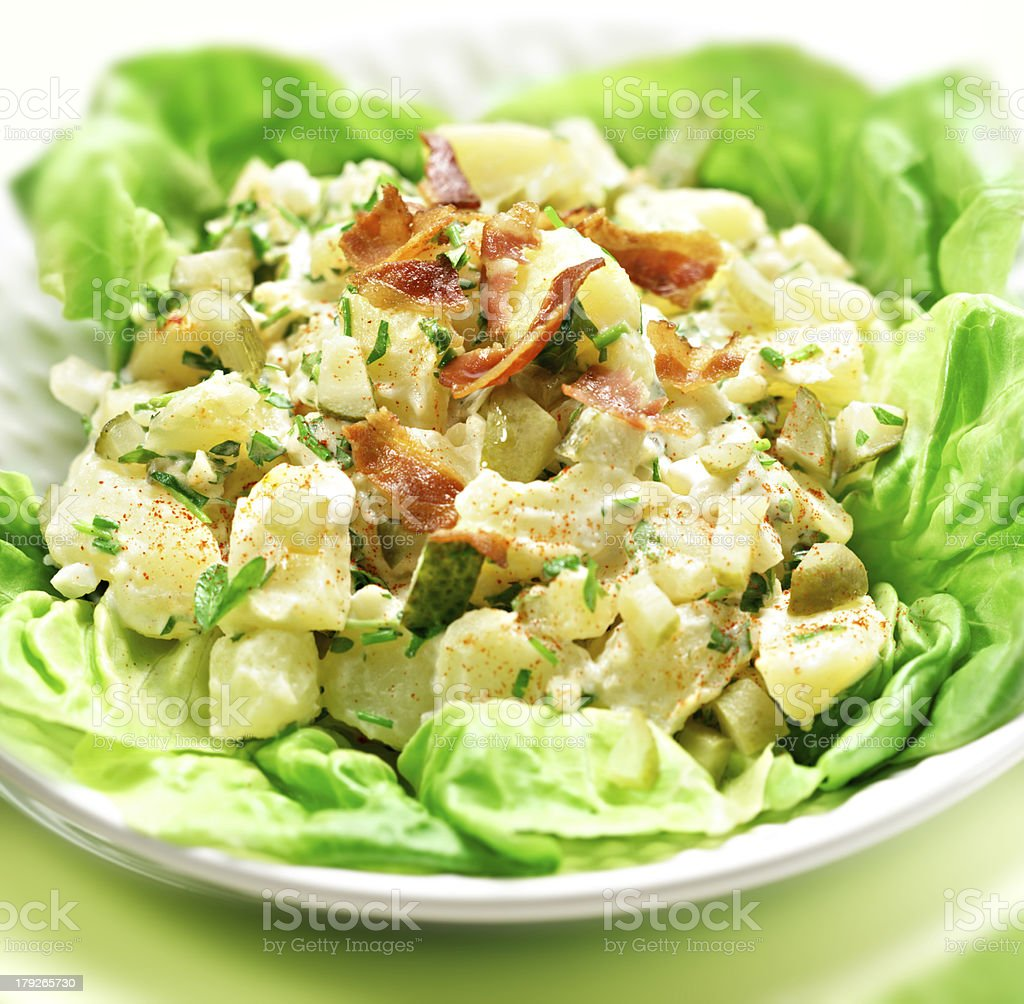 potato salad with letuce served in a bowl stock photo