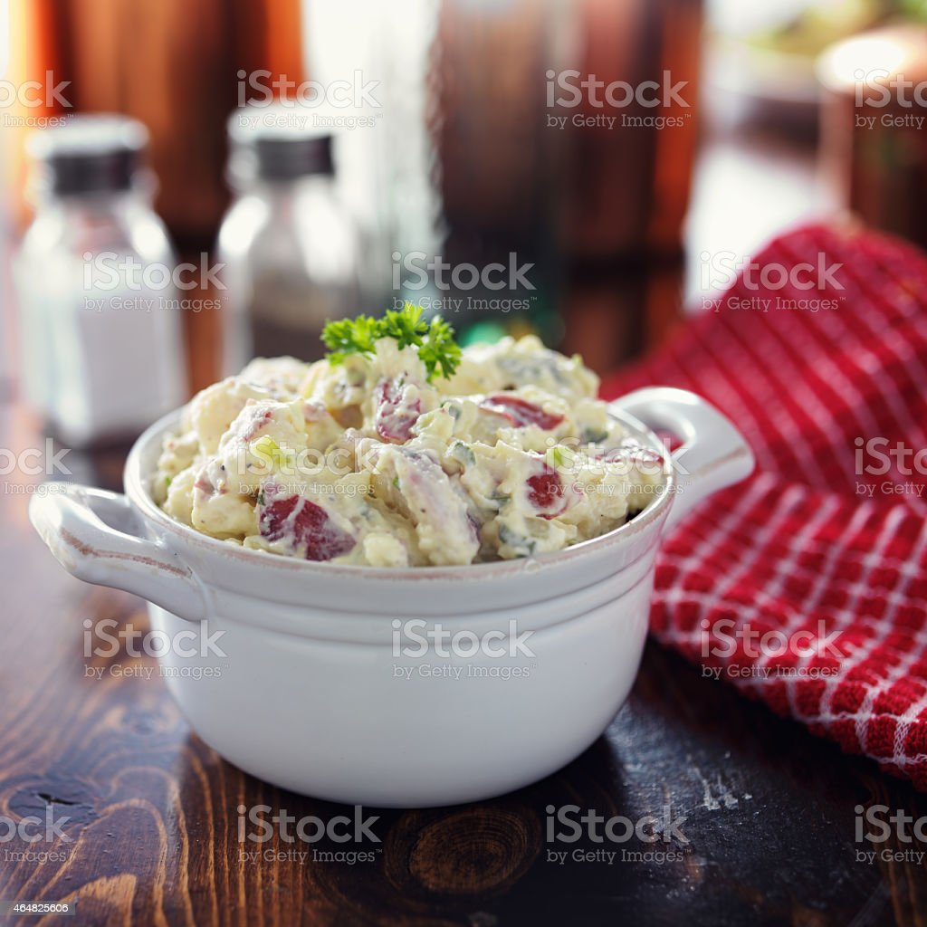 potato salad with parsley garnish stock photo