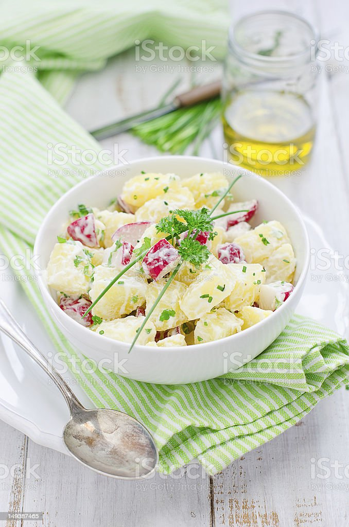 Potato salad with radishes stock photo