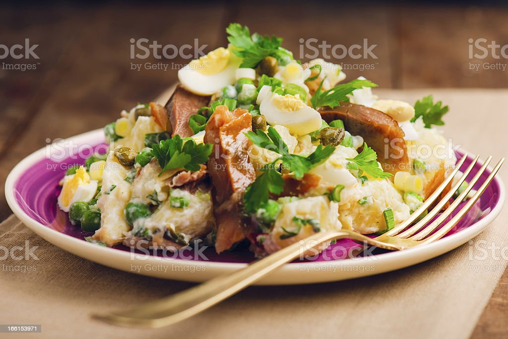 Potato salad with smoked fish royalty-free stock photo
